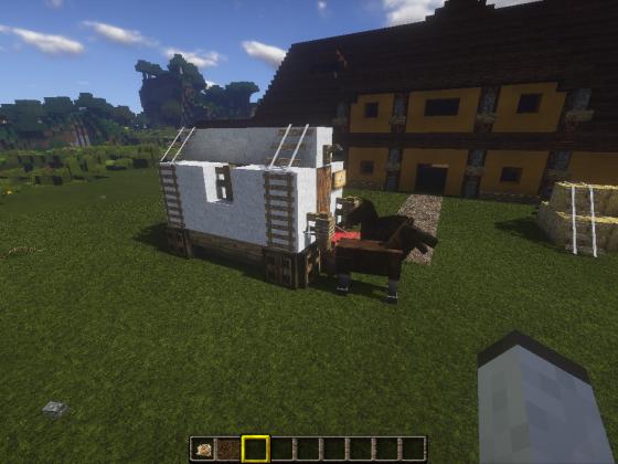 Kutsche und das Haupthaus der Farm